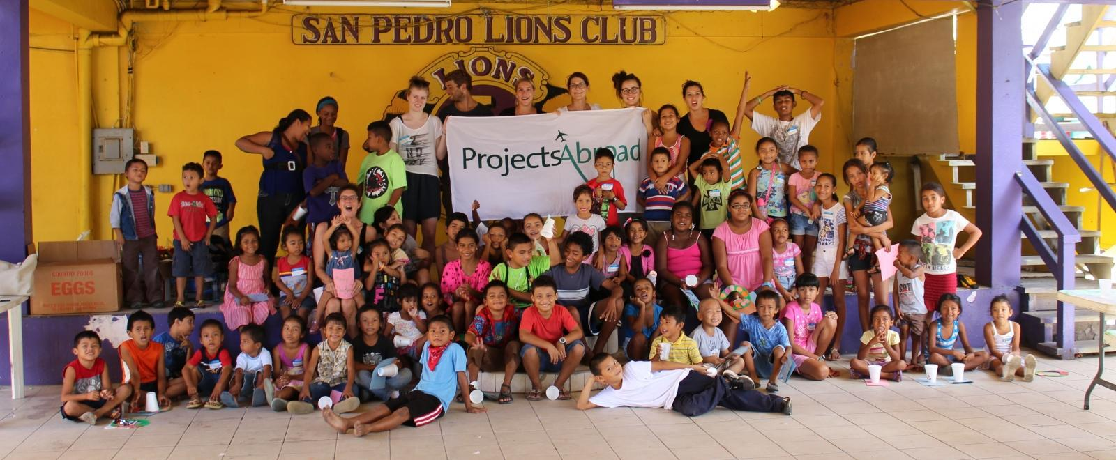 Projects Abroad volunteers working with children in Belize celebrate the end of a successful summer camp with local children.